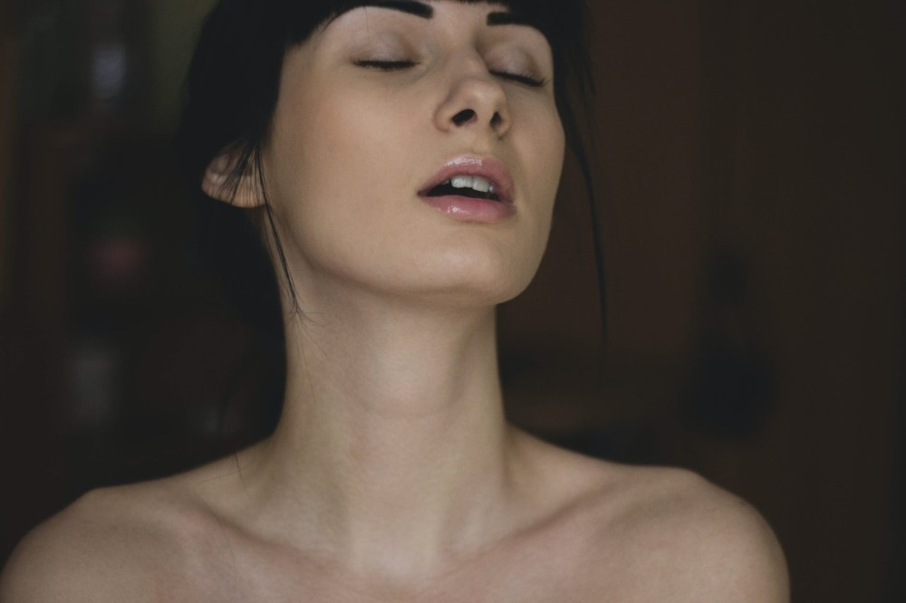 Woman Pleasuring Herself